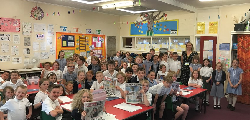 Budding reporters interview journalist for school paper